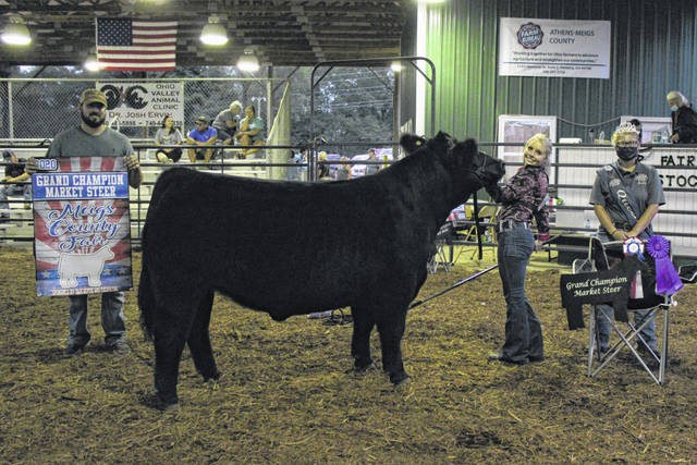 Jessica Parker's market beef steer was named Grand Champion in Tuesday evening's Meigs County Junior Fair Market Beef Steer Show. Also pictured is Fair Queen Kristin McKay.