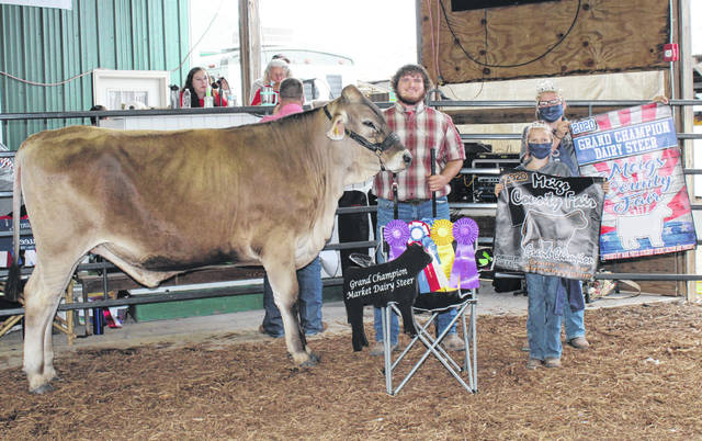 Coltin Parker took Grand Champion honors for his dairy steer and for showmanship.