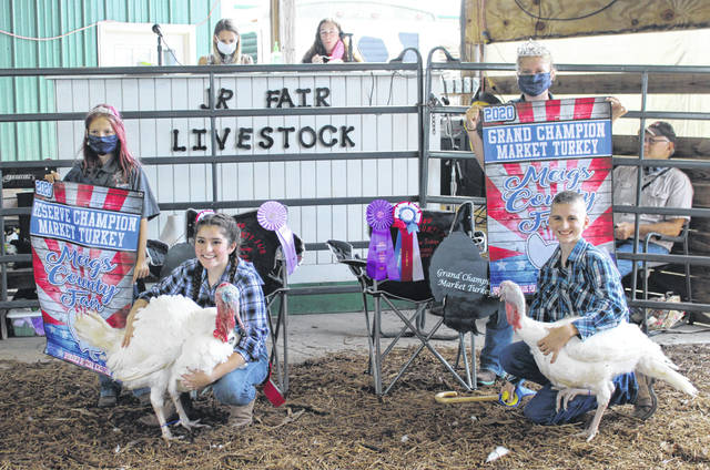 Bryant Mohler (front right) was named Grand Champion and Rachel Jackson (front left) Reserve Champion during the Meigs County Junior Fair Turkey Show on Tuesday. Also pictured are Livestock Princess Nevada Johnson and Fair Queen Kristin McKay.