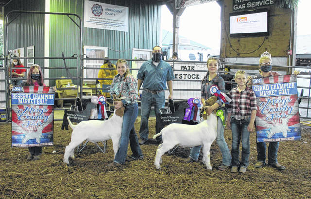 Alexa Ingels' goat (right) was named Grand Champion and Jennifer Parker's goat (left) Reserve Champion. Pictured holding Ingels' goat are her sisters Maddy Karr and Kensley Karr. Also pictured are Meigs County Fair Queen Kristin McKay and Livestock Princess Nevada Johnson.