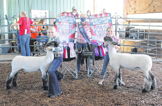 Reagan Burke (right) was named Grand Champion in the Market Sheep Show on Wednesday, with Jessica Parker named Reserve Champion. Also pictured is Fair Queen Kristin McKay.