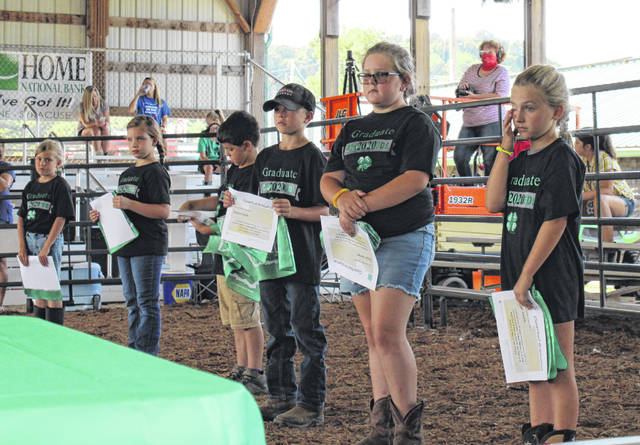 Members of the Cloverbud Class of 2020 line the show ring after receiving their certificates.