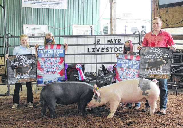 Jaycie Jordan (left) and Jacob Jordan (right) took top honors in the Meigs County Junior Fair Hog Show on Friday morning. Jaycie was named Grand Champion Showman and Grand Champion Market Hog, with Jacob taking Reserve Champion in both categories. Also pictured are Meigs County Fair Queen Kristin McKay and Livestock Princess Nevada Johnson.