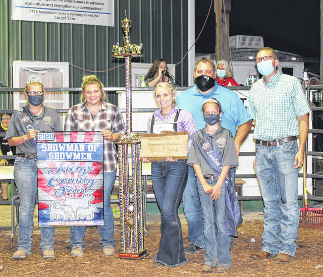 Jessica Parker (third from left) was named the 2020 Meigs County Showman of Showmen following Friday evening's competition. Also pictured (from left) are Meigs County Fair Queen Kristin McKay, 2019 Showman of Showmen winner Caelin Seth, Parker, Dan Short of Ohio Valley Bank (sponsor for the trophy, jacket and awards), Livestock Princess Nevada Johnson and judge Levi Richards.