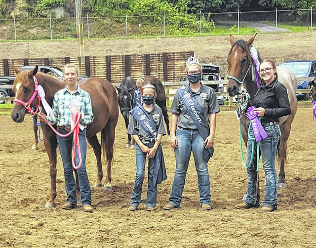 Shelbe Cochran was named the Grand Champion in Sr. Gymkhana Showmanship and Performance (includes barrel racing, pole bending, and keyhole). Makayla Smith won Reserve Champion in both classes. Pictured (left to right) are Makayla Smith, Livestock Princess Nevada Johnson, Fair Queen Kristin McKay, and Shelbe Cochran.