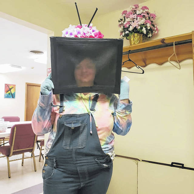 Sammy Eblin displays her TV Head that she made for her science and beyond category project.