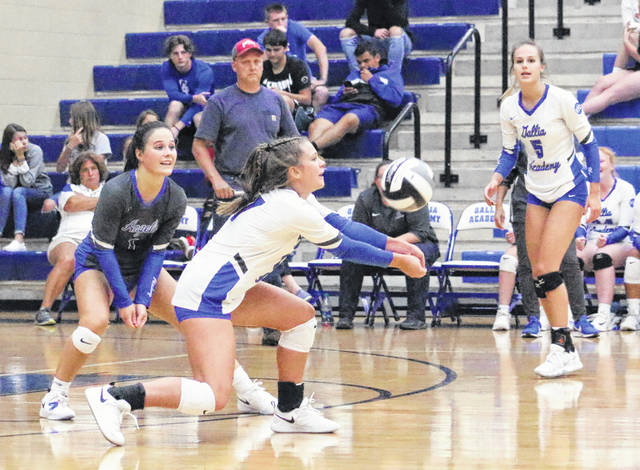 Gallia Academy freshman Callie Wilson bumps a ball in the air between teammates Jenna Harrison, left, and Alex Barnes (5) during a volleyball match against Alexander on Aug. 26, 2019, in Centenary, Ohio.