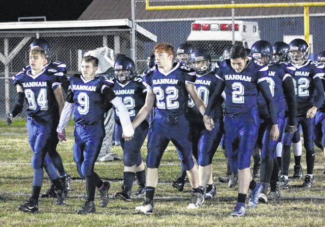 Members of the Hannan football team take the field before the start of a Senior Night contest against Tolsia on Nov. 8, 2019, at the Craigo Athletic Complex in Ashton, W.Va.