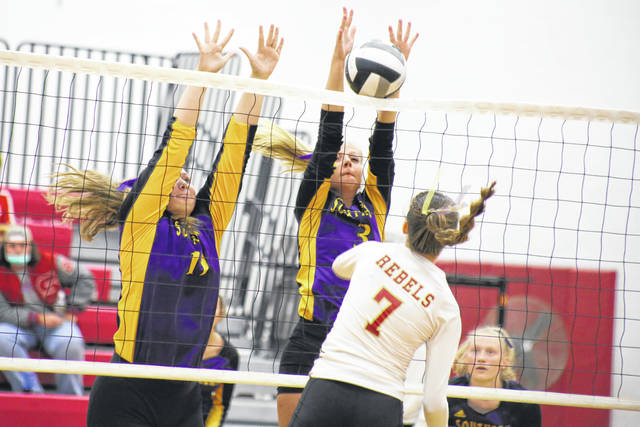 Southern's Kelsey Lewis (3), alongside teammate Logan Greenlee (left) blocks a spike attempt from South Gallia's Natalie Johnson (7), during the Lady Tornadoes 3-2 victory on Tuesday in Mercerville, Ohio.