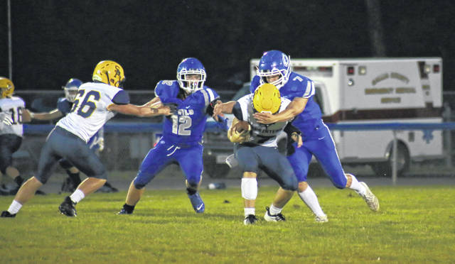 GAHS senior Zack Hemby (right), in front of classmate Trent Johnson (12), sacks South Point quarterback Malik Pegram eight yards behind the line of scrimmage during the Blue Devils' 41-0 victory on Aug. 28 in Gallipolis, Ohio.