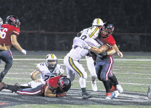 Point Pleasant senior Joel Beattie stops a Brooke ball carrier in his tracks during the second half of Friday night's football contest at OVB Field in Point Pleasant, W.Va.