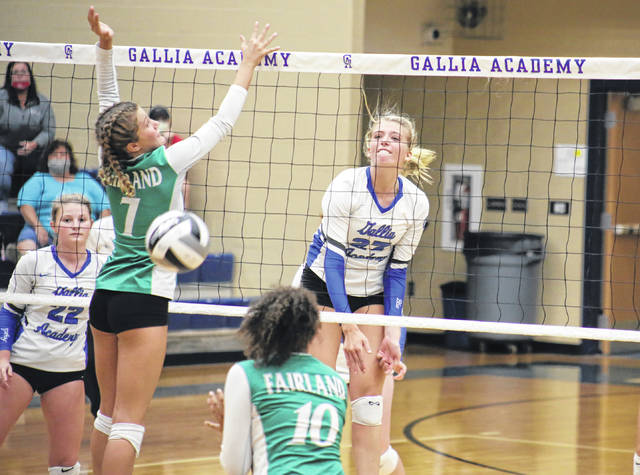Gallia Academy senior Maddy Petro (23) slams a spike between a pair of Lady Dragons, in front of GAHS setter Regan Wilcoxon (22), during the Blue Angels' straight games win on Thursday in Centenary, Ohio.
