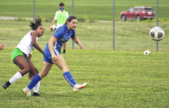 Gallia Academy junior Preslee Reed fires a shot in front of Fairland senior Nina Miller (left), during Thursday's 2-2 tie at Lester Field in Centenary, Ohio.