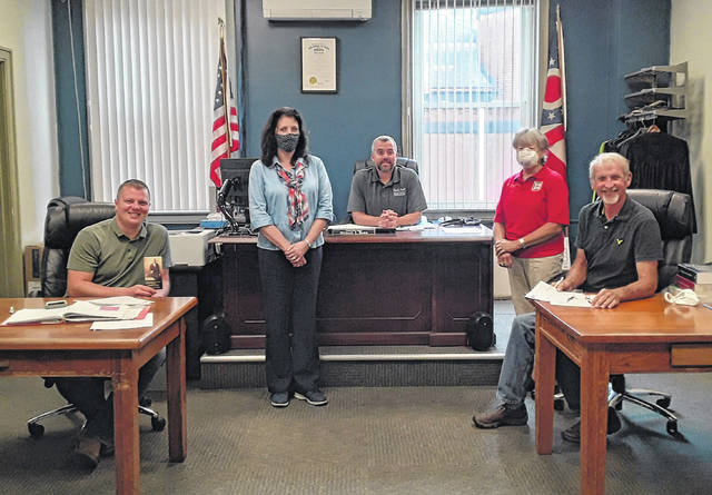 Return Jonathan Meigs DAR representatives Gina Tillis and Opal Grueser are pictured with the Meigs County Commissioners.