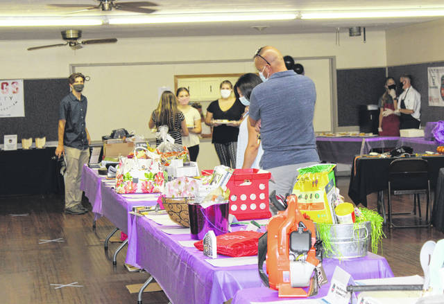 Masks and social distancing were part of the Chamber Day event held on Saturday at Kountry Resort.