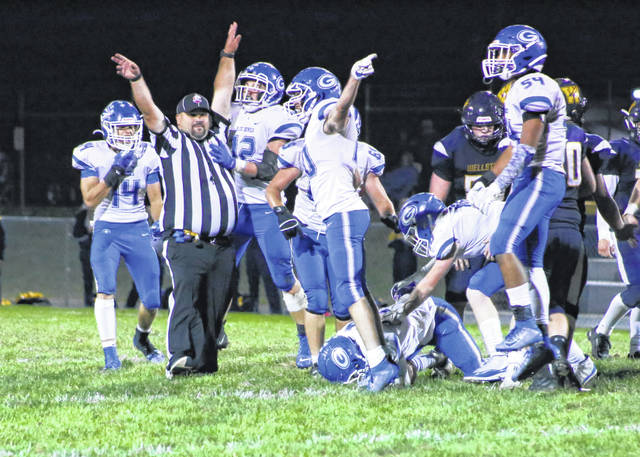 Members of the Gallia Academy football team react as teammate Cole Hines recovers a fourth quarter fumble during Saturday night's football contest against Wellston at C.H. Jones Field in Wellston, Ohio.