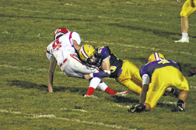 Southern senior Josh Stansberry (25) sacks the Trimble quarterback, during the second half of the Tomcats' 57-0 victory on Friday in Racine, Ohio.
