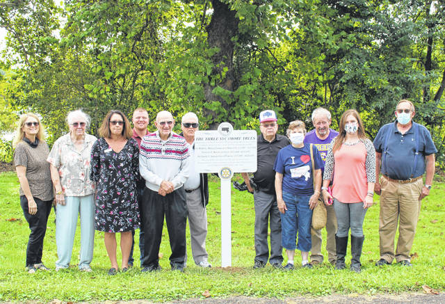 Representatives from the Middleport-Pomeroy Rotary Club and the Meigs County Historical Society are pictured with the marker which was recently unveiled.