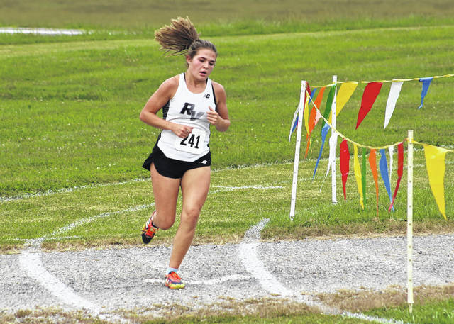 River Valley junior Lauren Twyman rounds a corner during the 2020 Federal Hocking Cross Country Invitational held Wednesday night at Federal Hocking High School in Stewart, Ohio.