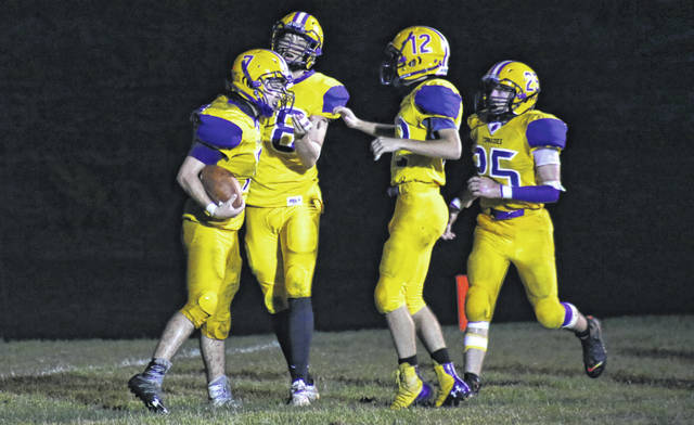Southern junior Jonah Diddle (7) celebrates a third quarter touchdown with teammates Damien Miller, Blake Shain (12) and Josh Stansberry (25), during the Tornadoes' 32-6 win on Friday in Racine, Ohio.