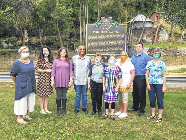 Meigs County Historical Society trustees (from left) Laurie Reed, Susan Clark-Dingess, Jill Cochran, Shannon Scott, Mary G. Cowdery, Molly Arms, Debbie Pratt, James Stanley, and Patty Grossnickle are pictured with the Campbell marker.