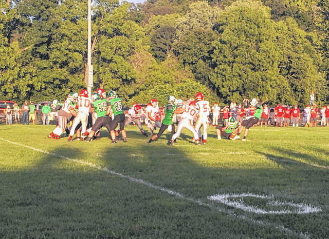 High school football entered week two Ohio on Friday night. Pictured here, Eastern place kicker Conner Ridenour makes an extra point attempt during the first quarter of Friday's game at East Shade River Stadium. Local teams playing their first home games were the Meigs Marauders who hosted the River Valley Raiders, the Eastern Eagles who hosted the Trimble Tomcats, and the South Gallia Rebels who hosted the Waterford Wildcats. The Southern Tornadoes were on the road for the second consecutive week, traveling to face the Belpre Golden Eagles. The Gallia Academy Blue Devils took to the road for the first time in 2020, facing the Ironton Fighting Tigers. Due to early press times, complete game coverage won't appear in print until Tuesday's print edition. However, stories will appear on our websites and Facebook pages as soon as they are available. (Alex Hawley | OVP Sports)