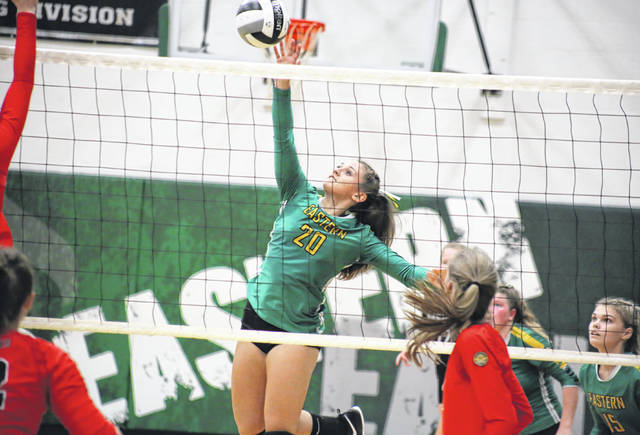 EHS junior Megan Maxon (20) spikes the ball over the net, during a non-league match on Monday in Tuppers Plains, Ohio.