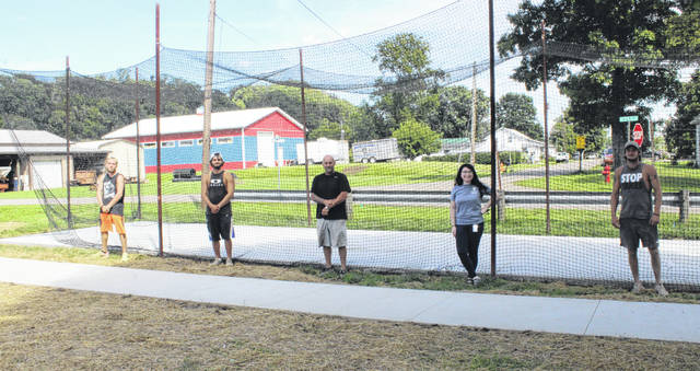 Pictured at the new batting cage and sidewalk area are Dakota Kowell, Dylan Smith, Chris Smith, Sara Hill and Jacob Robie.