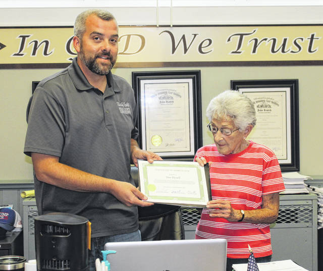 Dee Hysell was recognized during last week's commissioner meeting for her volunteer work with the Humane Society. Hysell is pictured with Meigs County Commissioner Randy Smith.