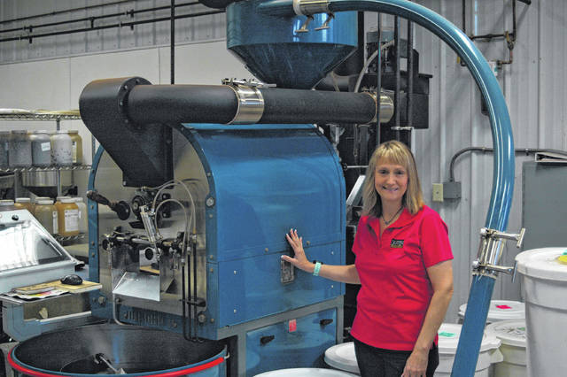 Ohio Valley Publishing profiled Silver Bridge Coffee in 2018. Pictured from that story, is Lorraine Walker with the main roasting machine at Silver Bridge Coffee, which used infrared technology to roast the beans efficiently. (OVP File Photo)