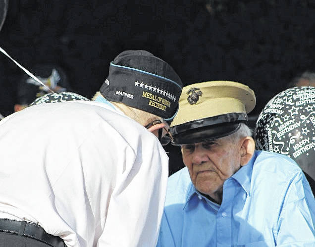 Ray Stith, 100-year old veteran of Point Pleasant, visits with Medal of Honor recipient Hershel Woody Williams on Friday. (Beth Sergent | OVP)