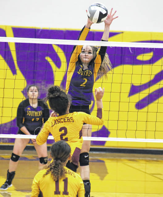 Southern senior Kylie Gheen blocks a Lady Lancers spike attempt, during the Lady Tornadoes' 3-1 victory on Thursday in Racine, Ohio.