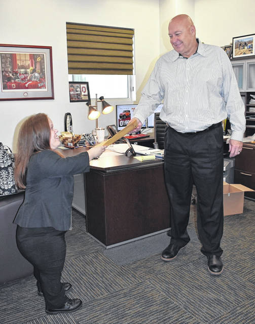 October is National Dwarfism Awareness Month, and as Mason County's lone adult little person, Jennifer Yonker said she feels it is her duty to educate people every day. Pictured, Yonker, standing at exactly four feet, is quite a contrast to her employer, Mark Porter, who is well over six feet tall. (Mindy Kearns | Courtesy)