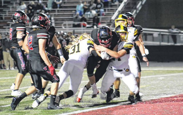 PPHS sophomore Evan Roach fights off a pair of KHS defenders, and crosses the goal line, during the Big Blacks' 38-28 victory on Friday in Point Pleasant, W.Va.