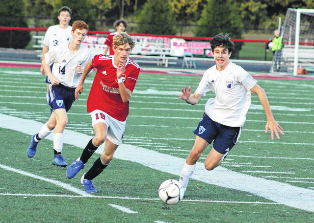 Point Pleasant sophomore Colton Young (19) runs down a loose ball during the first half of Thursday's boys soccer contest against Spring Valley at OVB Field in Point Pleasant, W.Va.