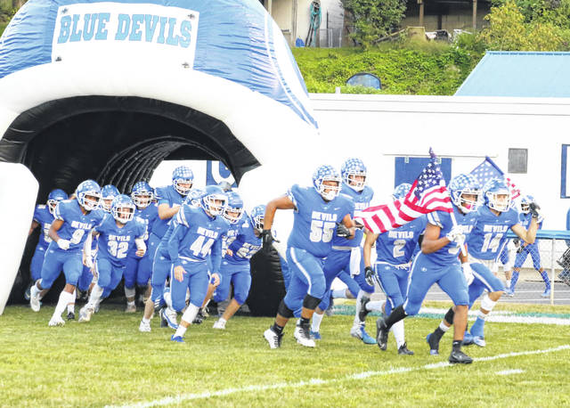 Members of the Gallia Academy football team take the field before the start of an Ohio Valley Conference contest against Fairland on Sept. 25 at Memorial Field in Gallipolis, Ohio.