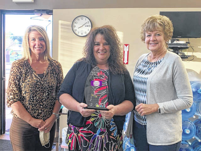 Julie Mayer (center) was recently recognized by the Gallia-Jackson-Meigs Alcohol, Drug Addition & Mental Health Board as the Meigs County Champion in the fight against drug addiction. Picture with Mayer are Angela Stowers and Robin Harris of the Gallia-Jackson-Meigs ADAMH Board.