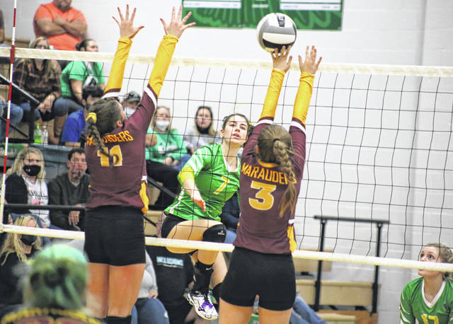 Eastern senior Alisa Ord (7) spikes the ball over a block attempt from Lady Marauders Hannah Durst (11) and Morgan Denney (3), during the Lady Eagles' straight games victory on Wednesday in Tuppers Plains, Ohio.