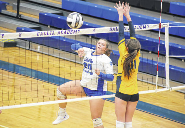 Gallia Academy sophomore Chanee Cremeens (20) spikes the ball past a SPHS defender, during the Blue Angels' straight games victory on Thursday in Centenary, Ohio.