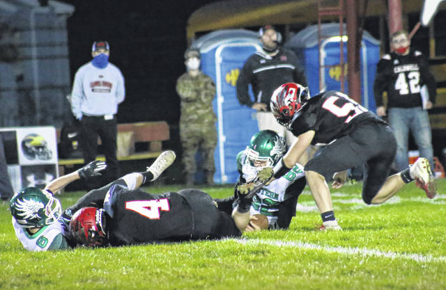 Eastern senior Brad Hawk (82) recovers a fumble forced by Bryce Newland (6), during the Eagles' 26-14 playoff victory on Friday in Caldwell, Ohio.