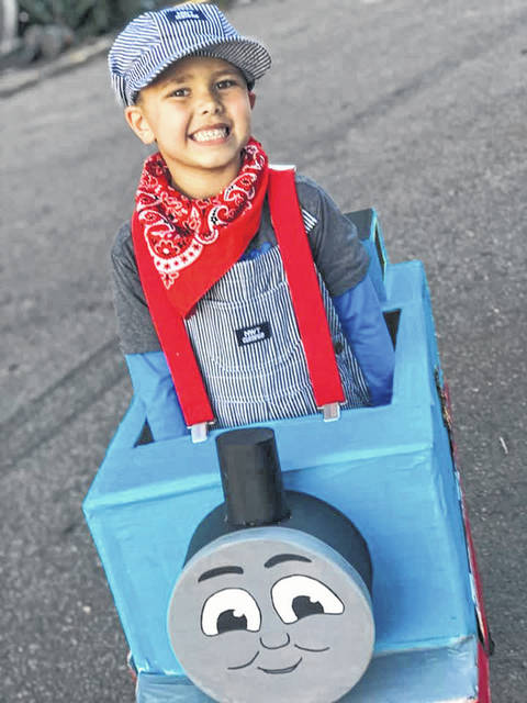 Owen is pictured in his Thomas the Train costume for Trick or Treat 2019.