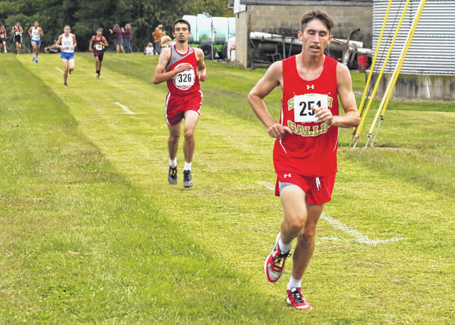 South Gallia senior Garrett Frazee, right, leads a pack of runners at the Federal Hocking Invitational held Sept. 23 in Stewart, Ohio.