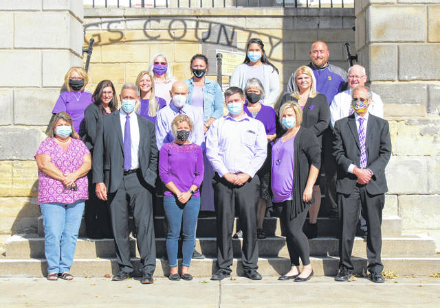 Representatives from the Meigs County Prosecutor's Office, Clerk of Courts, Common Pleas Court and Victim Assistance Office wore purple to raise awareness for Domestic Violence Awareness Month.