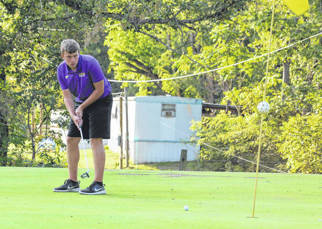Southern junior Tanner Lisle watches a putt move along on the ninth hole during a Sept. 22 golf match at Riverside Golf Course in Mason, W.Va.