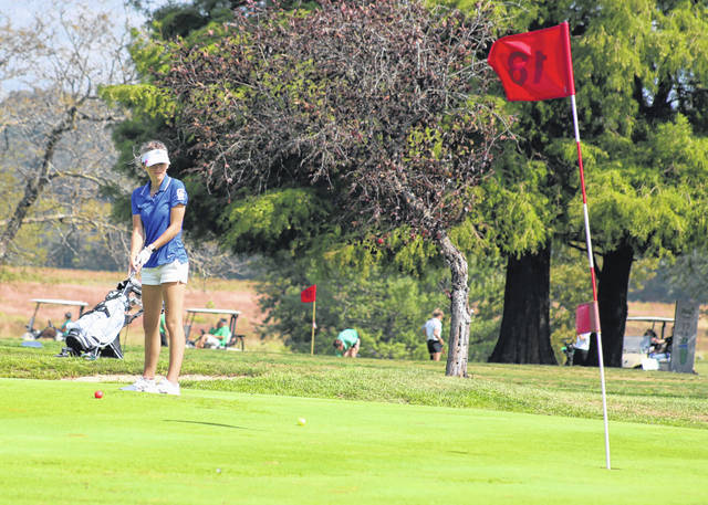 Gallia Academy senior Avery Minton hits a putt on the 18th hole during the Division II Southeast sectional golf championships held Sept. 28 at Franklin Valley Golf Course in Jackson, Ohio.