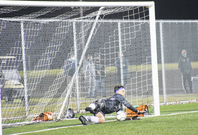 PPHS senior Luke Pinkerton makes a diving stop in goal, during the Class AA-A semifinal on Friday in Beckley, W.Va.