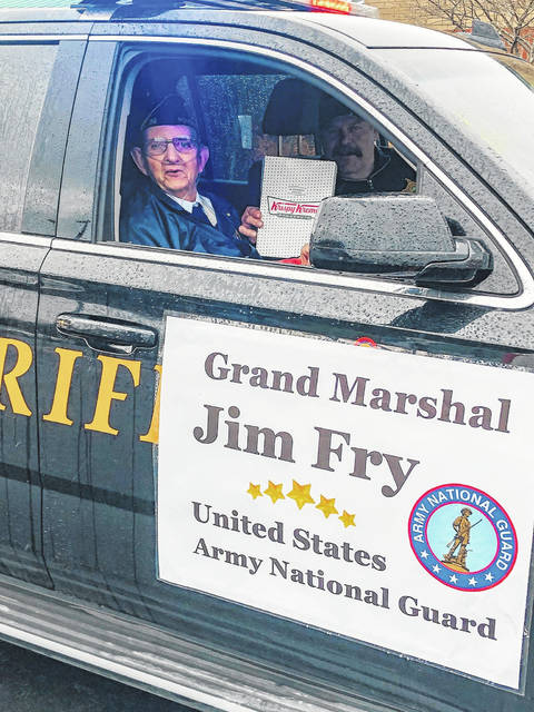 Grand Marshal Jim Fry is pictured riding with Meigs County Sheriff Keith Wood.