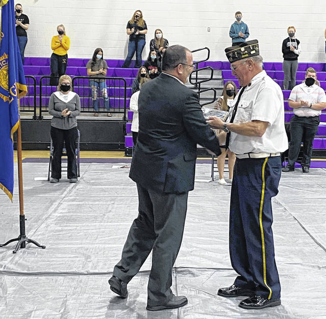 Superintendent Tony Deem presented 2020 Honoree Denny Evans with a plaque during Wednesday's Veteran's Day ceremony.