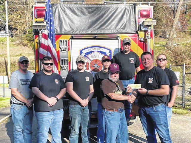 The 8th annual Pomeroy Firemen's Association Food Drive benefited the Meigs Cooperative Parish. The Pomeroy Firemen's Association collected 1,772 non-perishable food items and $1,267, all of which goes to the parish to stock the shelves throughout the winter months. Pictured are firemen's association members Aaron Oliphant, Ben Young, Tyler Peyton, Jake Musser, Richard Peyton and Eddie Fife, Jr. Presenting a check to Bud Randolph of the Meigs Cooperative Parish is Fire Chief Derek Miller. The Firemen's Association also thanks Hilda Weaver for her continued support of the food drive and organizing the pickup of all food items and money at the conclusion of the event.