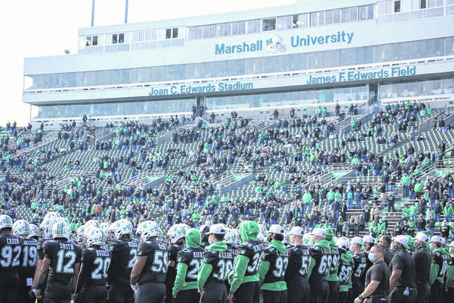 """On Saturday, the Marshall University community remembered the 75 people who lost their lives in a plane crash 50 years prior, including several members of the Marshall football team and coaching staff. Pictured is this year's Thundering Herd team wearing its """"75"""" helmets prior to the game against Middle Tennessee State which is covered inside this edition and online. More on Saturday's remembrances in an upcoming article. (Bryan Walters 
